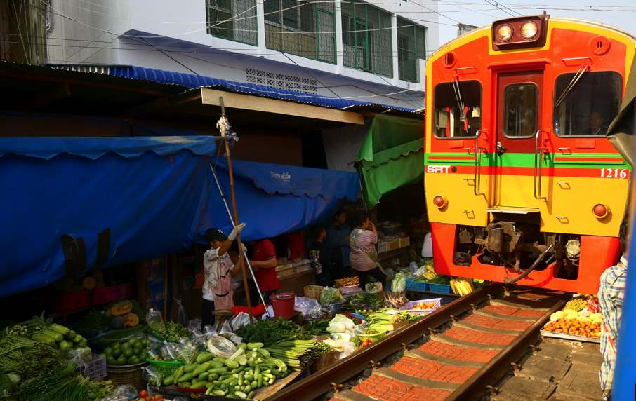 Maeklong Railway Market (train market)